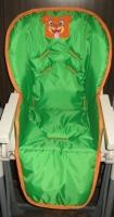 žalia su siuvinėtu paveiksliuku